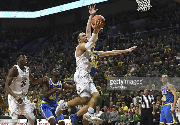 Dillon Brooks of the Oregon Ducks drives to the basket on TJ Leaf of the UCLA Bruins during the first half of the game at Matthew Knight Arena on...