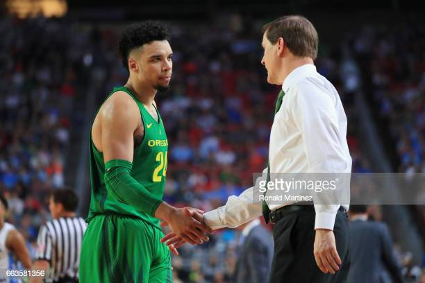 Dillon Brooks of the Oregon Ducks shakes hands with head coach Dana Altman after fouling out in the second half against the North Carolina Tar Heels...