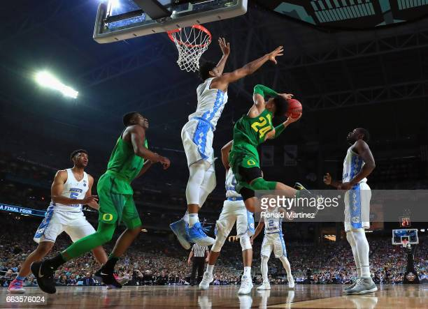 Dillon Brooks of the Oregon Ducks shoots against Isaiah Hicks of the North Carolina Tar Heels in the second half during the 2017 NCAA Men's Final...