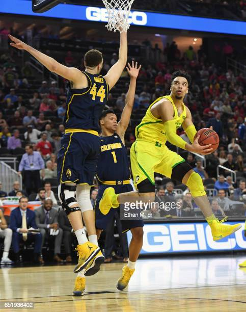 Dillon Brooks of the Oregon Ducks shoots against Kameron Rooks and Ivan Rabb of the California Golden Bears during a semifinal game of the Pac12...