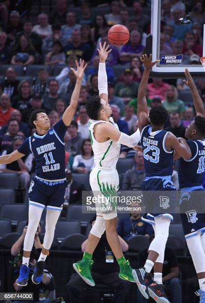 Dillon Brooks of the Oregon Ducks shoots over Jeff Dowtin and Kuran Iverson of the Rhode Island Rams during the second round of the 2017 NCAA Men's...
