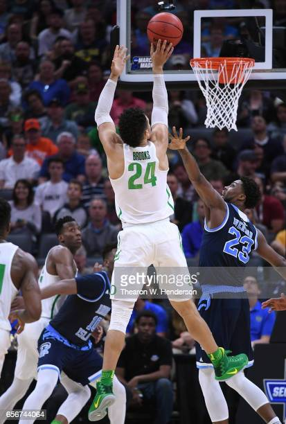 Dillon Brooks of the Oregon Ducks shoots over Kuran Iverson of the Rhode Island Rams during the second round of the 2017 NCAA Men's Basketball...