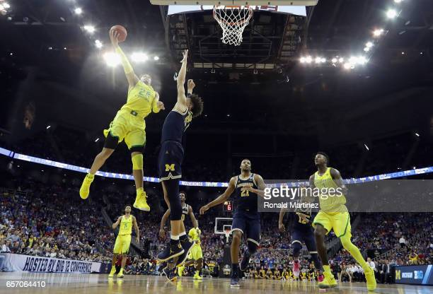 Dillon Brooks of the Oregon Ducks shoots the ball against DJ Wilson of the Michigan Wolverines in the second half during the 2017 NCAA Men's...