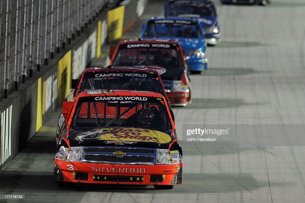 TY Dillon. driver of the #3 Bass Pro Shops/Tracker Boats Chevrolet races with other trucks during the Camping World Truck Series UNOH 200 at Bristol Motor Speedway on August 21, 2013 in Bristol, Tennessee.