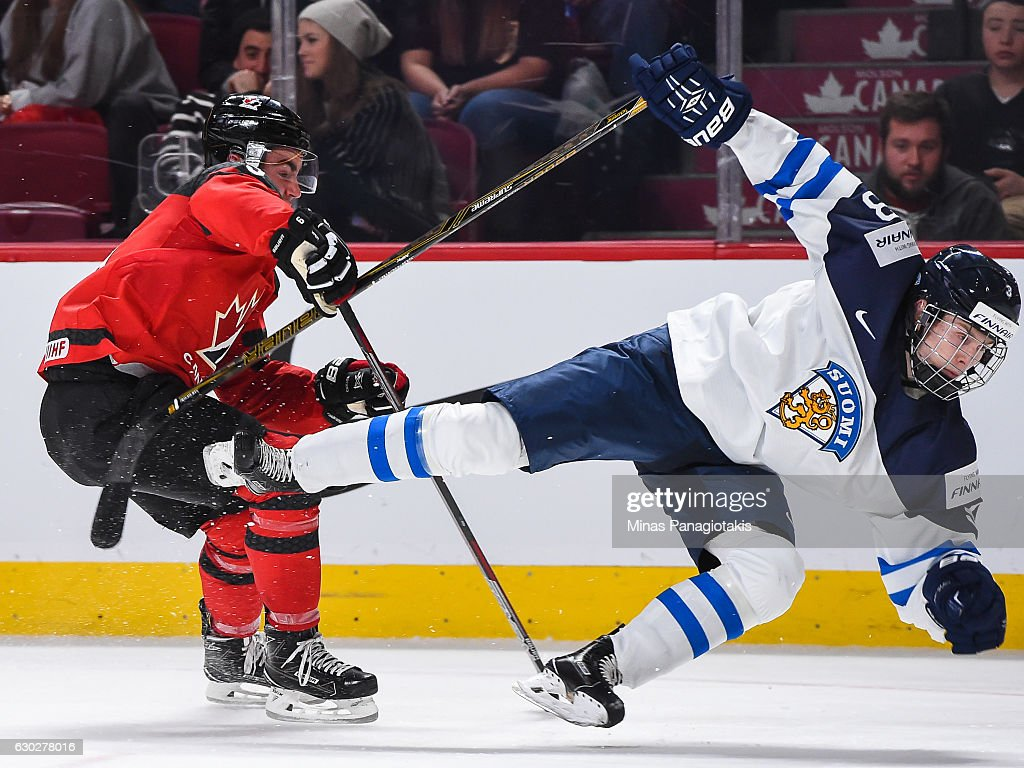Dillon Dube #9 of Team Canada takes down Urho Vaakanainen of Team Finland #3 during the IIHF exhibition game at the Bell Centre on December 19, 2016 in Montreal, Quebec, Canada. Team Canada defeated Team Finland 5-0.