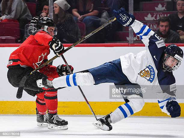 Dillon Dube of Team Canada takes down Urho Vaakanainen of Team Finland during the IIHF exhibition game at the Bell Centre on December 19 2016 in...