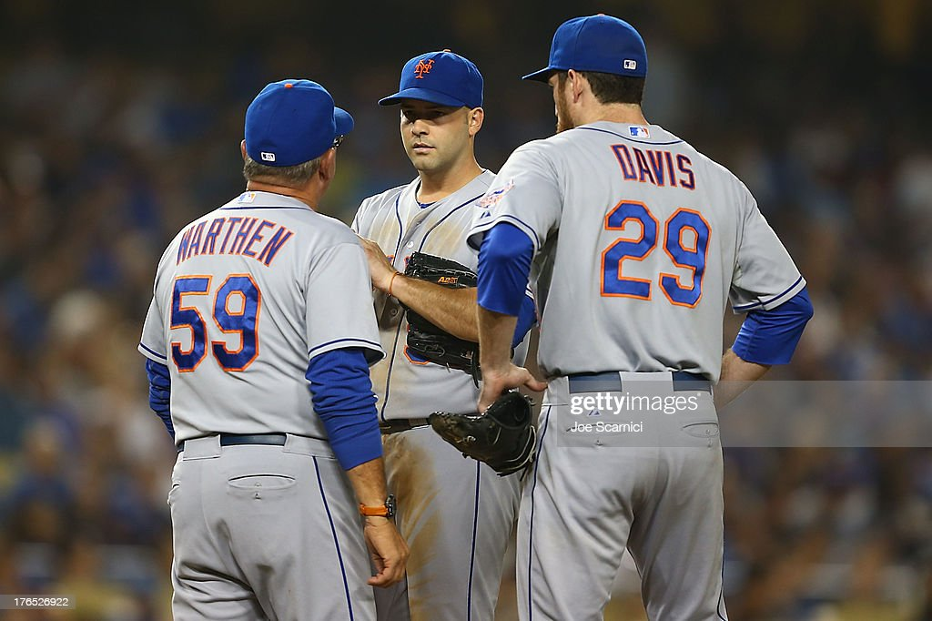 <a gi-track='captionPersonalityLinkClicked' href=/galleries/search?phrase=Dillon+Gee&family=editorial&specificpeople=5741589 ng-click='$event.stopPropagation()'>Dillon Gee</a> #35 of the New York Mets has a talk with Dan Warthen #59 of the New York Mets and <a gi-track='captionPersonalityLinkClicked' href=/galleries/search?phrase=Ike+Davis&family=editorial&specificpeople=2349664 ng-click='$event.stopPropagation()'>Ike Davis</a> #29 of the New York Mets in the fourth inning during the game against the Los Angeles Dodgers at Dodger Stadium on August 14, 2013 in Los Angeles, California.