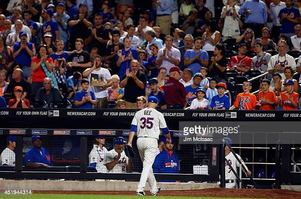 Dillon Gee of the New York Mets is applauded as he leaves the game in the eighth inning against the Atlanta Braves at Citi Field on July 9 2014 in...
