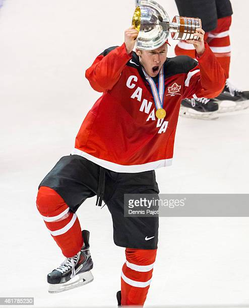 Dillon Heatherington of Canada celebrates with the trophy after a 54 win against Russia during the Gold medal game of the 2015 IIHF World Junior...