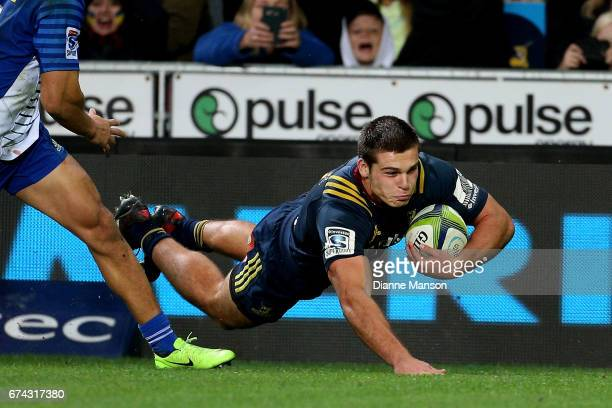 Dillon Hunt of the Highlanders dives over to score during the round 10 Super Rugby match between the Highlanders and the Stormers at Forsyth Barr...