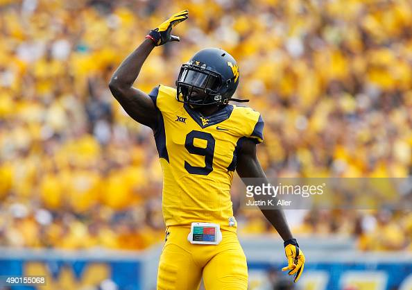 Dillon of the West Virginia Mountaineers pumps up the crowd in the first quarter during the game against the West Virginia Mountaineers on September...