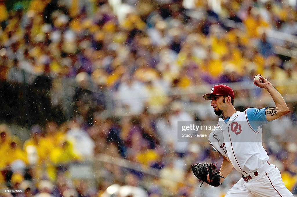 Dillon Overton #13 of the Oklahoma Sooners prepares to throw a pitch in the rain against the LSU Tigers during Game 2 of the NCAA baseball Super Regionals at Alex Box Stadium on June 8, 2013 in Baton Rouge, Louisiana.