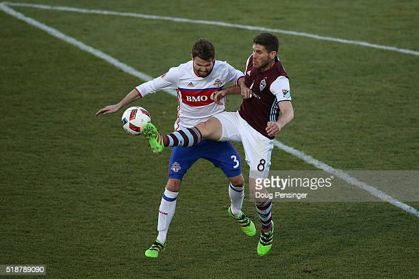 Dillon Powers of Colorado Rapids controls the ball against Drew Moor of Toronto FC at Dick's Sporting Goods Park on April 2 2016 in Commerce City...