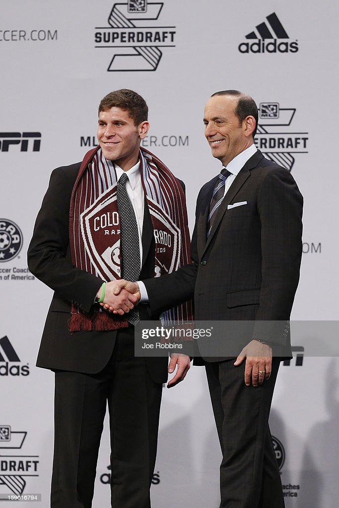 Dillon Powers (L) of Notre Dame shakes hands with commissioner Don Garber after being selected by the Colorado Rapids as the 11th overall pick in the 2013 MLS SuperDraft Presented by Adidas at the Indiana Convention Center on January 17, 2013 in Indianapolis, Indiana.