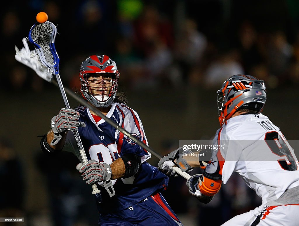 Dillon Roy #91 Denver Outlaws defends as <a gi-track='captionPersonalityLinkClicked' href=/galleries/search?phrase=Paul+Rabil&family=editorial&specificpeople=4307127 ng-click='$event.stopPropagation()'>Paul Rabil</a> #99 of the Boston Cannons looks to pass at Harvard Stadium on May 11, 2013 in Boston, Massachusetts. Denver 20n 14-10.