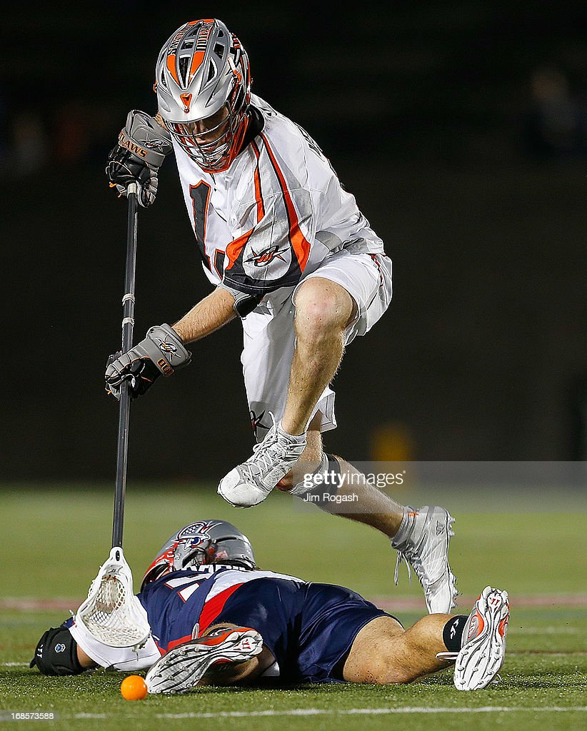 Dillon Roy #91 of the Denver Outlaws jumps over <a gi-track='captionPersonalityLinkClicked' href=/galleries/search?phrase=Paul+Rabil&family=editorial&specificpeople=4307127 ng-click='$event.stopPropagation()'>Paul Rabil</a> #99 of the Boston Cannons to lead the offense in the second half at Harvard Stadium on May 11, 2013 in Boston, Massachusetts. Denver 20n 14-10.
