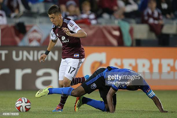 Dillon Serna of the Colorado Rapids is fouled by Patrice Bernier of the Montreal Impact at Dick's Sporting Goods Park on May 24 2014 in Commerce City...