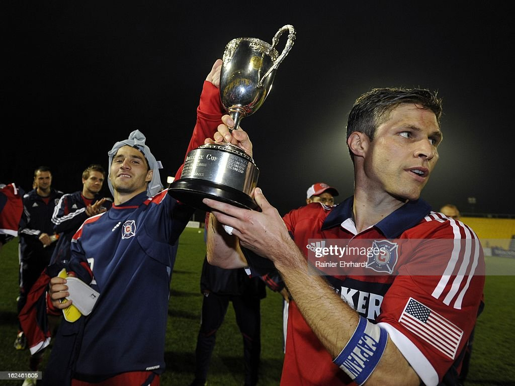 Dilly Duka (L) #8 of the Chicago Fire and team captain Logan Pause #12 hold the Carolina Challenge Cup after a draw against the Vancouver Whitecaps FC at Blackbaud Stadium on February 23, 2013 in Charleston, South Carolina.