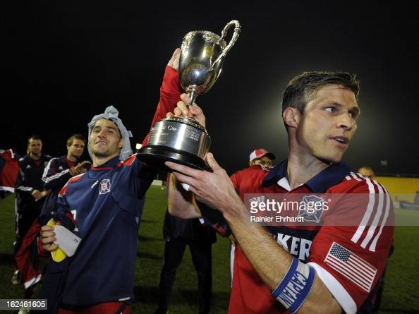 Dilly Duka of the Chicago Fire and team captain Logan Pause hold the Carolina Challenge Cup after a draw against the Vancouver Whitecaps FC at...
