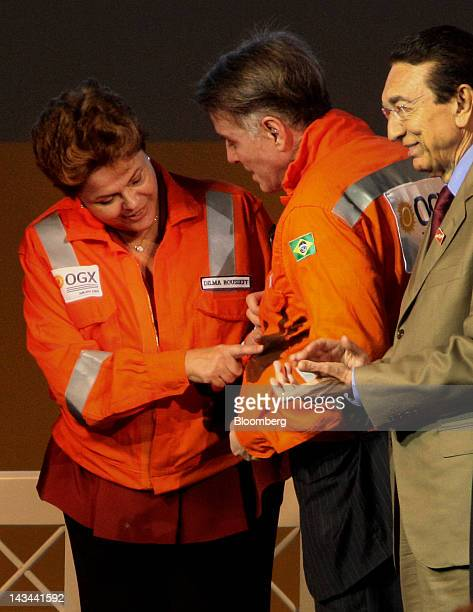 Dilma Rouseff Brazil's president and Brazilian billionaire Eike Batista try on oil worker's vest during a visit to the port of Acu in Sao Joao da...