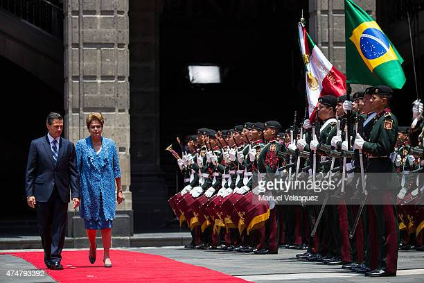 Dilma Rousseff President of Brazil walks nex to Enrique Peña Nieto President of Mexico during an official reception ceremony at Palacio Nacional on...