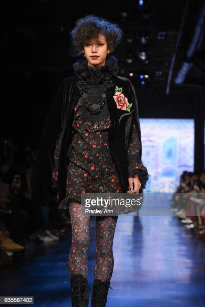 Dilone Janiece walks the runway at the Anna Sui Fall/Winter 2017 Show at Skylight Clarkson Sq on February 15 2017 in New York City
