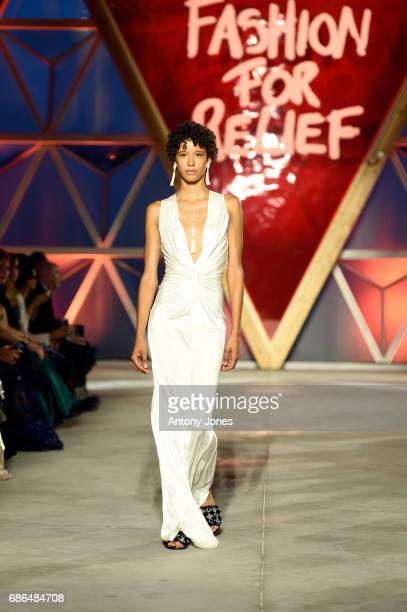Dilone walks the runway at the Fashion for Relief event during the 70th annual Cannes Film Festival at Aeroport Cannes Mandelieu on May 21 2017 in...