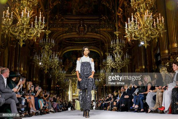 Dilone walks the runway during the Balmain show as part of the Paris Fashion Week Womenswear Spring/Summer 2018 on September 28 2017 in Paris France
