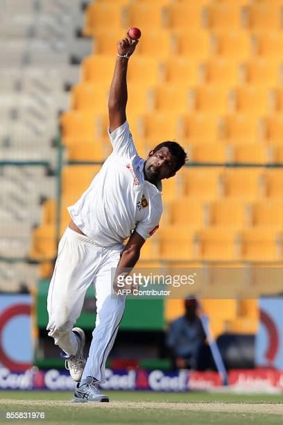 Dilruwan Perera of Sri Lanka bowls during the third day of the first Test cricket match between Pakistan and Sri Lanka at Sheikh Zayed Stadium in Abu...