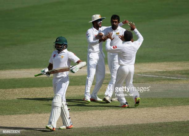 Dilruwan Perera of Sri Lanka celebrate with teammates after dismissing Sami Aslam of Pakistan during Day Three of the Second Test between Pakistan...