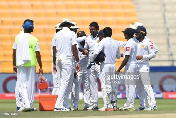Dilruwan Perera of Sri Lanka celebrates taking the wicket of Sami Aslam of Pakistan during Day Three of the First Test between Pakistan and Sri Lanka...