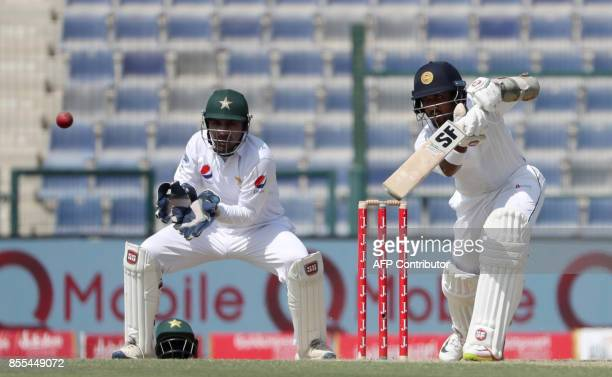 Dilruwan Perera of Sri Lanka plays a shot during the second day of the first Test cricket match between Sri Lanka and Pakistan at Sheikh Zayed...
