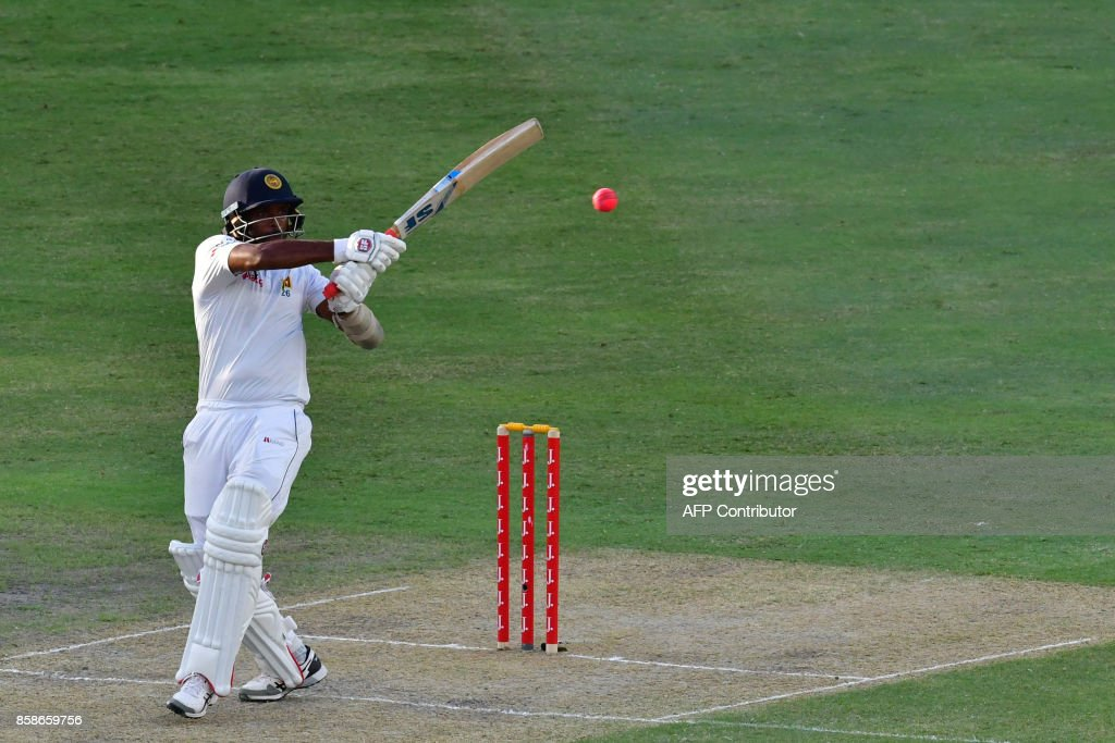 Dilruwan Perera of Sri Lanka plays a shot during the second day of the second Test cricket match between Sri Lanka and Pakistan at Dubai International Stadium in Dubai on October 7, 2017. /