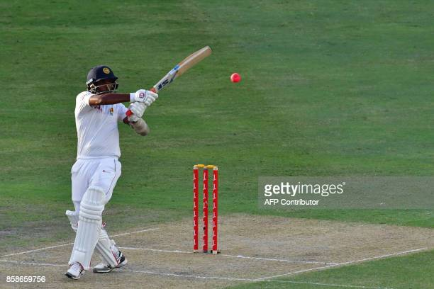 Dilruwan Perera of Sri Lanka plays a shot during the second day of the second Test cricket match between Sri Lanka and Pakistan at Dubai...