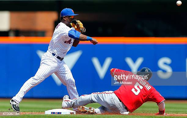 Dilson Herrera of the New York Mets attempts a first inning double play after forcing out Yunel Escobar of the Washington Nationals at Citi Field on...