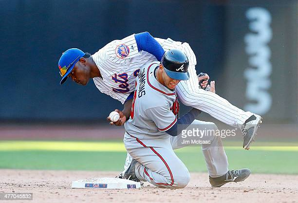 Dilson Herrera of the New York Mets can't complete a ninth inning double play attempt after a collision against Andrelton Simmons of the Atlanta...