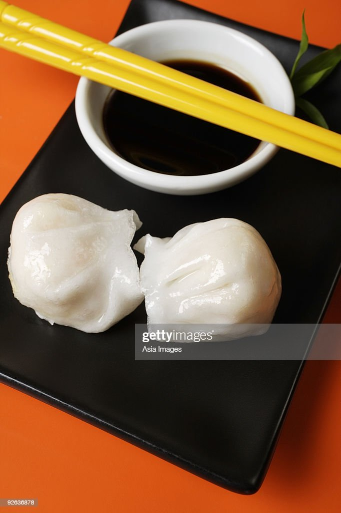 Dim sum on plate with soy sauce : Stock Photo