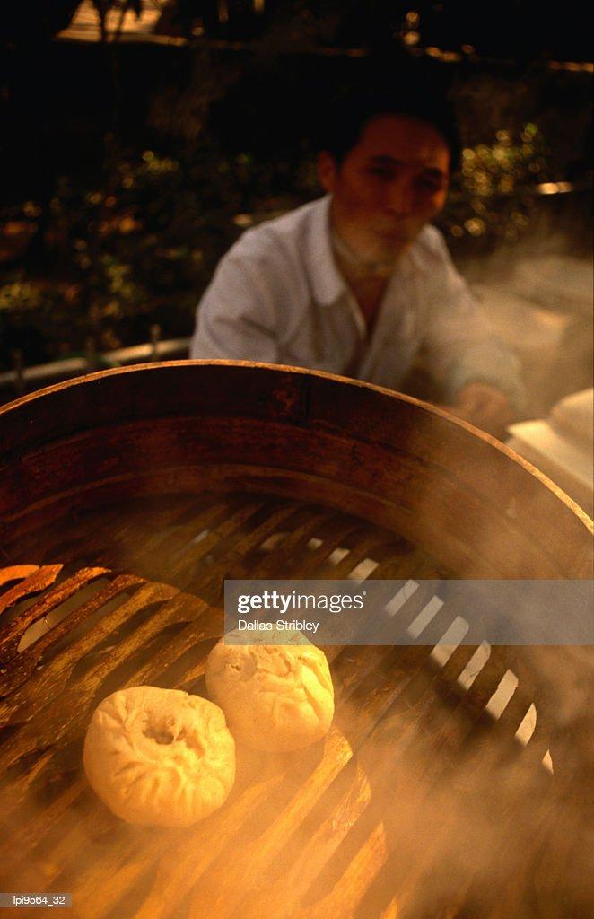 Dim sum siew loong pau (or steamed Shanghai dumplings) cooking in street stall. : Stock Photo