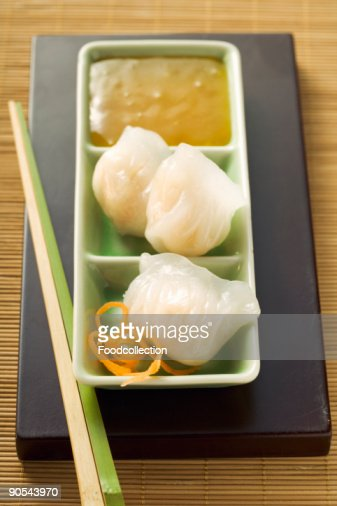 Dim sum with sweet and sour sauce, close up : Stock Photo