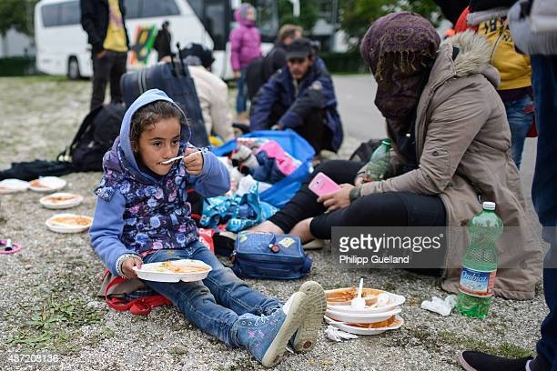 Dima from Syria enjoys a meal at a refugee accomodation facility in an exhibition hall on September 7 2015 in Munich Germany German authorities are...