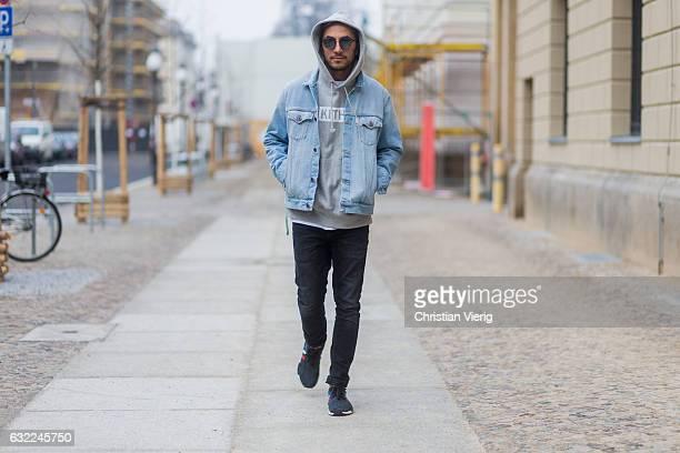 Dima wearing OFF WHITE acid wash denim jacket Neil Barret Jeans Kith Miami Sweatshirt Sneaker Adidas NMD R1 Dior Magnitude Sunglasses during the...