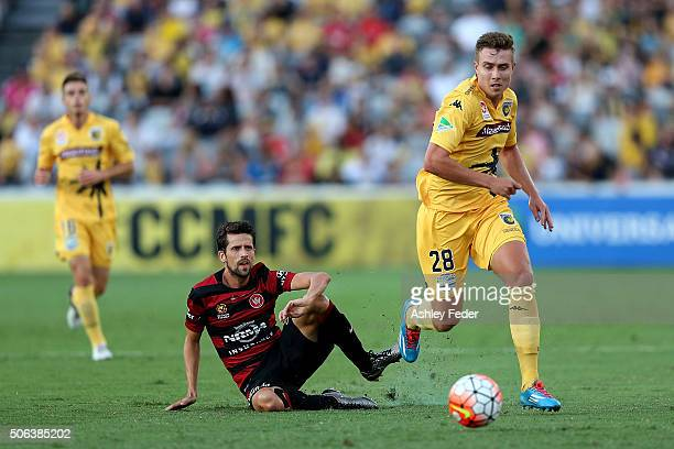 Dimas Delgado of the Wanderers is challenged by Matthew Fletcher of the Mariners during the round 16 ALeague match between the Central Coast Mariners...