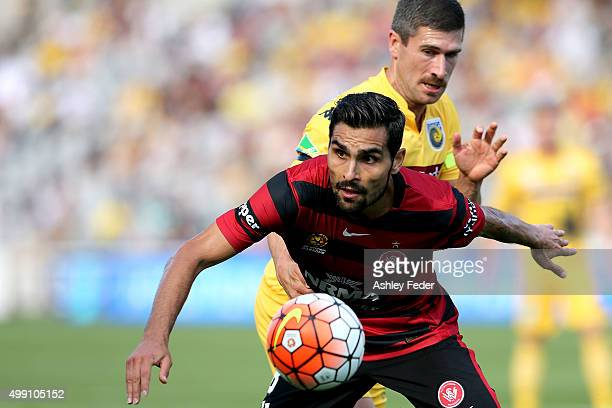 Dimas Delgado of the Wanderers is contests by Nick Montgomery of the Mariners during the round eight ALeague match between the Central Coast Mariners...