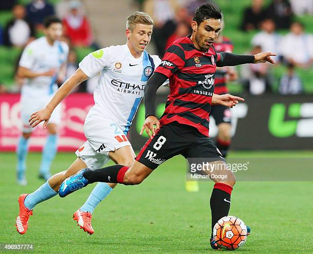 Dimas Delgado of the Wanderers kicks the ball against Stefan Mauk of the City during the round six ALeague match between Melbourne City FC and the...
