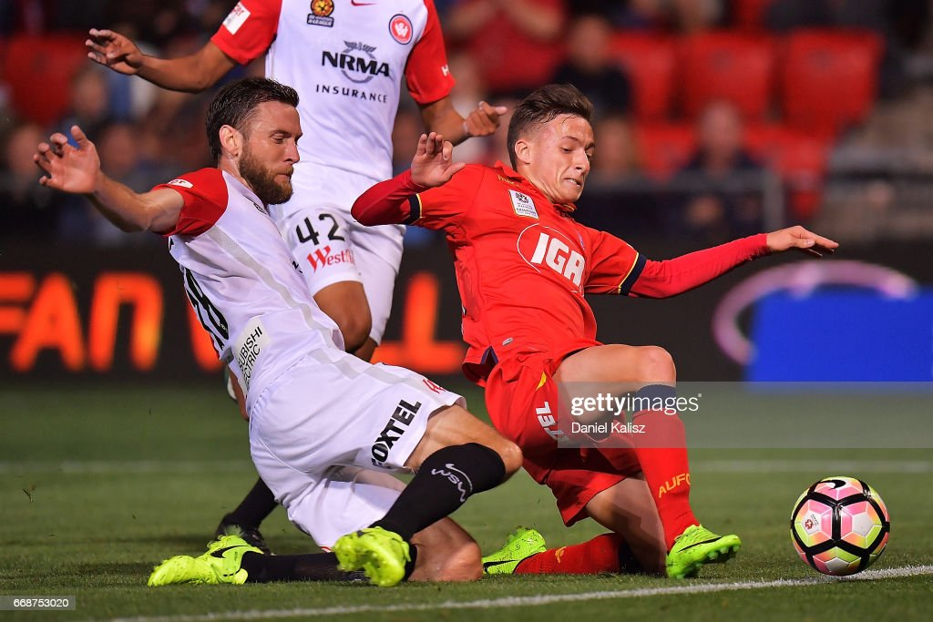 Dimas of the Wanderers and Jordan O'Doherty of United compete for the ball during the round 27 A-League match between Adelaide United and the Western Sydney Wanderers at Coopers Stadium on April 15, 2017 in Adelaide, Australia.