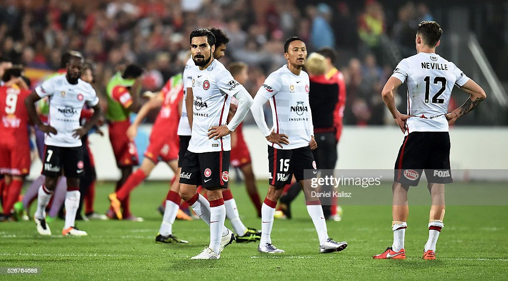 Dimas of the Wanderers and Scott Neville of the Wanderers look on dejected after the 2015/16 A-League Grand Final match between Adelaide United and the Western Sydney Wanderers at Adelaide Oval on May 1, 2016 in Adelaide, Australia.