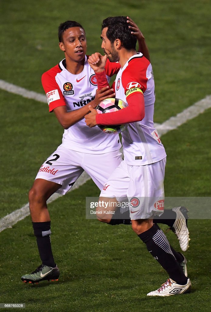Dimas of the Wanderers celebrates with Keanu Baccus of the Wanderers during the round 27 A-League match between Adelaide United and the Western Sydney Wanderers at Coopers Stadium on April 15, 2017 in Adelaide, Australia.