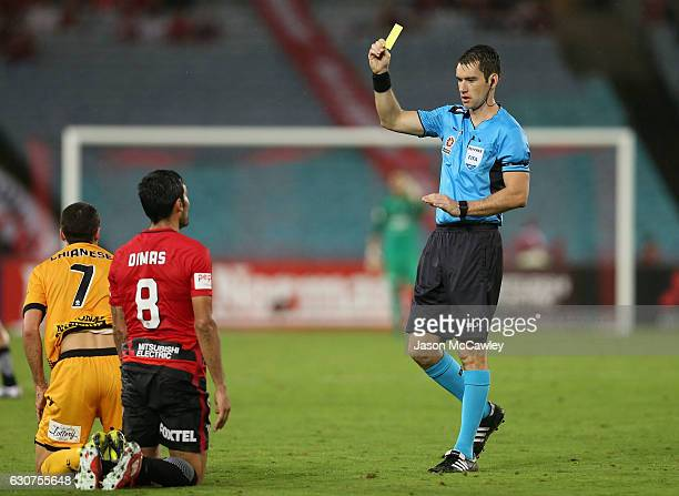 Dimas of the Wanderers receives a yellow card from referee Jarred Gillett during the round 13 ALeague match between the Western Sydney Wanderers and...