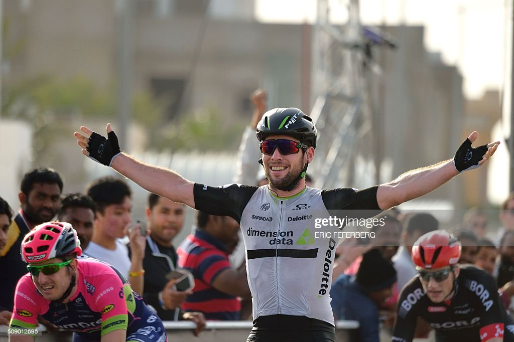 Dimension Data team leader, Britain's Mark Cavendish, celebrates as he crosses the finish line at the end of the first stage of the 2016 Tour of Qatar, between Dukhan and Al Khor Corniche on February 8, 2016 north of the Qatari capital Doha. Cavendish, the former world road race champion, took the gold jersey and covered the 175 kilometres from Dukhan to the Al Khor corniche in 3hrs 28.31secs, eight seconds in front of Modolo and 11 seconds ahead of Guardini. / AFP / ERIC FEFERBERG