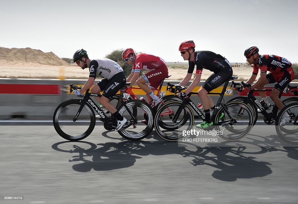 Dimension Data team leader, Britain's Mark Cavendish (L), leads the pack ahead of Norway's Katusha team leader Alexander Kristoff (2ndL), Bora's German Christophe Pfingsten (2ndR) and BMC racing team's Italian Manuel Quinziato (R) during the first stage of the 2016 Tour of Qatar, between Dukhan and Al Khor Corniche on February 8, 2016. Cavendish, the former world road race champion, took the gold jersey and covered the 175 kilometres from Dukhan to the Al Khor corniche, north of the capital Doha, in 3hrs 28.31secs, eight seconds in front of Modolo and 11 seconds ahead of Guardini. / AFP / ERIC FEFERBERG